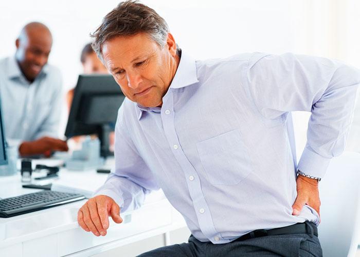 Боль в спине при переломе копчика