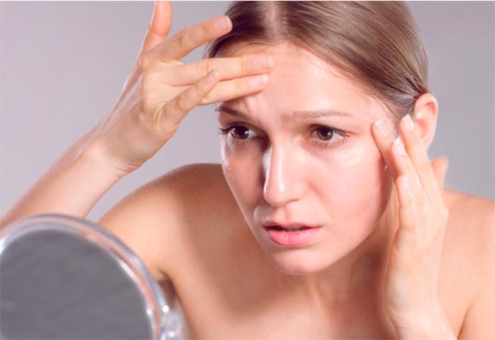 Поиск симптомов преждевременного старения кожи лица